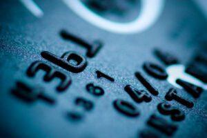 teal credit card digits close-up